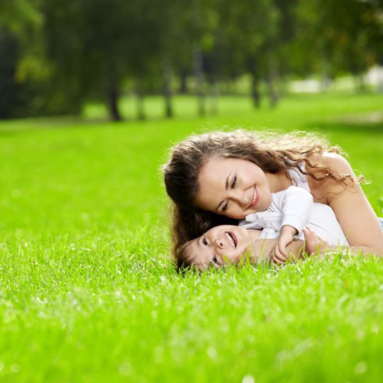 Mom and child on lawn